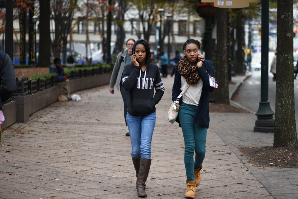 two-girls-walking-downtown.jpg