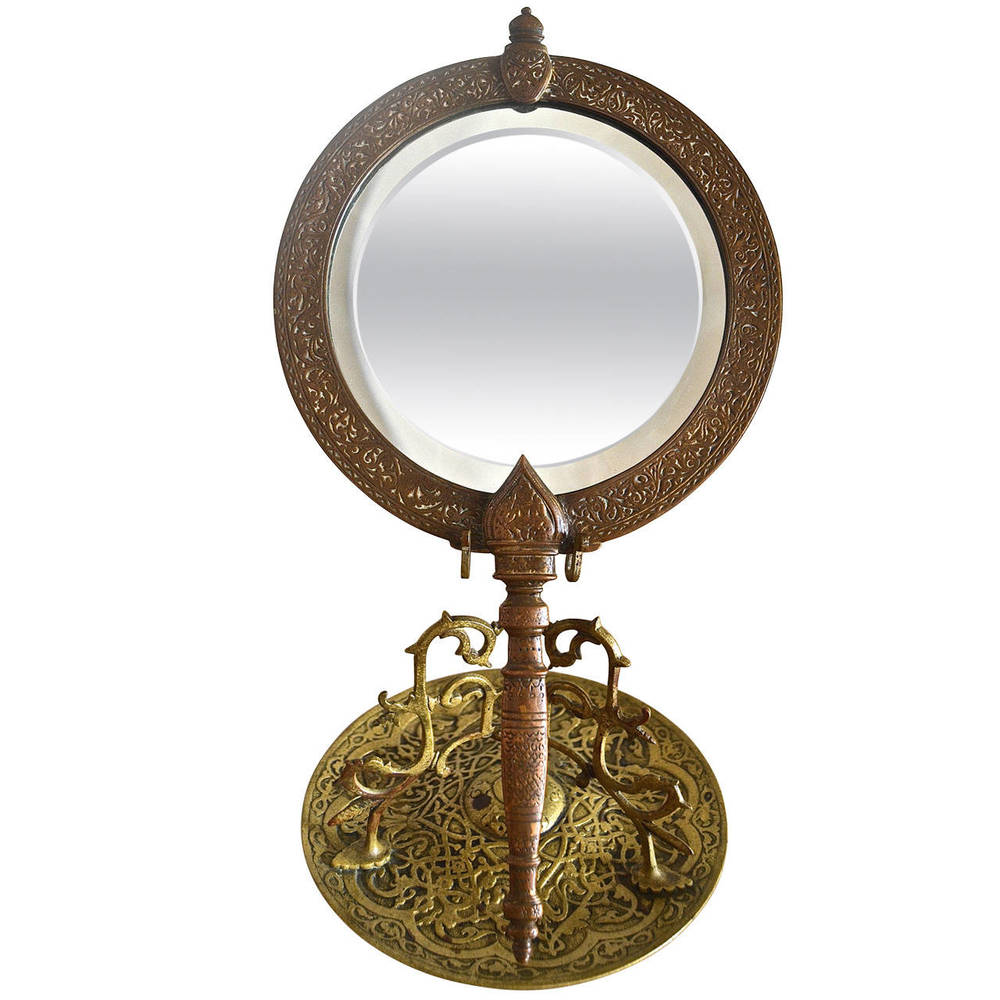 "Tiffany & Co.   ""Alhambra"" Bronze Mirror $4,500"