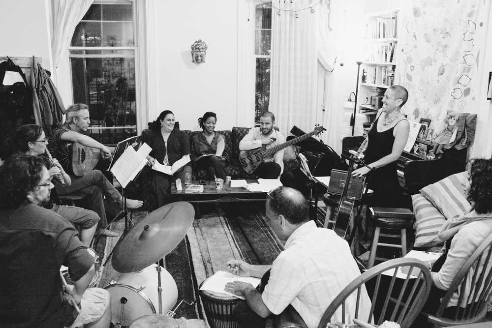 Web EZUZ_whole band living room rehearsal.jpg