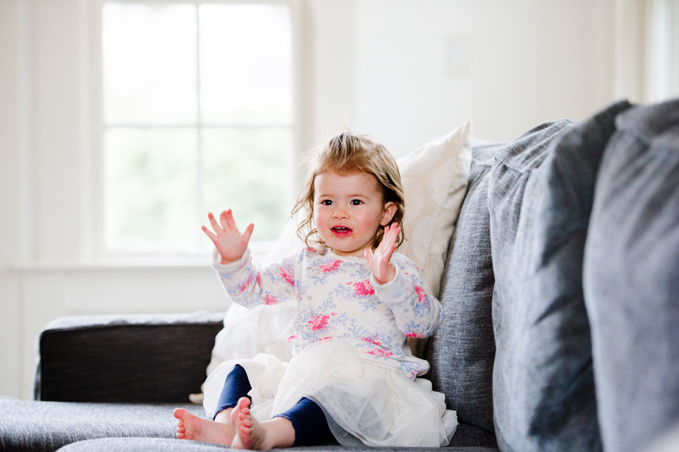 beautiful portrait of toddler clapping