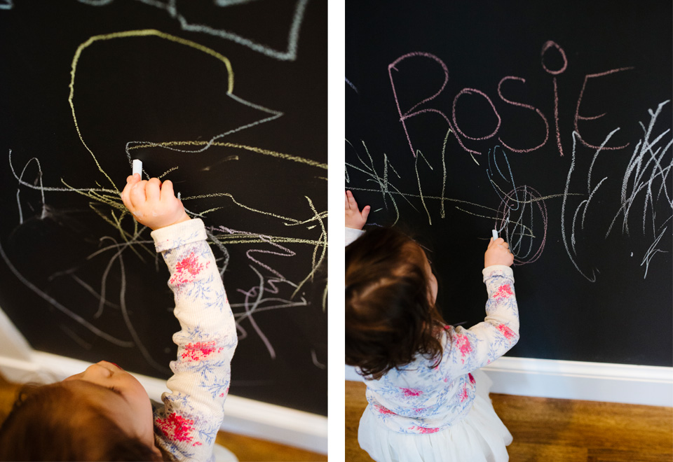 adorable toddler colors on chalkboard wall