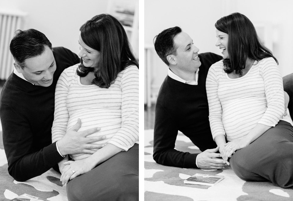 couple looking at mother's pregnant belly while smiling