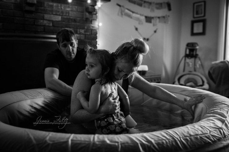 This mother leaned on her daughter during the intensity of labor. Beautiful work by Jessie Fultz.