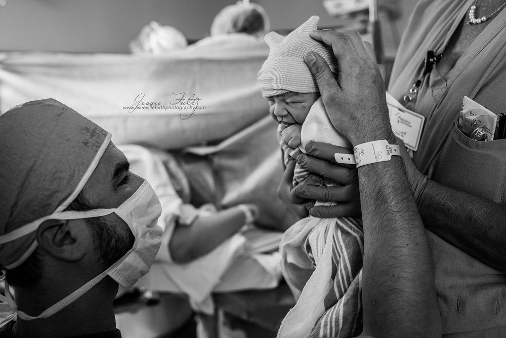 Seeing their baby for the very first time. Beautiful.    www.ashevillebirthphotography.com