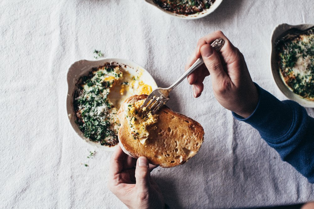 Eggs + cream + butter + garlic + parmesan + herbs = the easiest most delicious breakfast to spread on buttered toast.