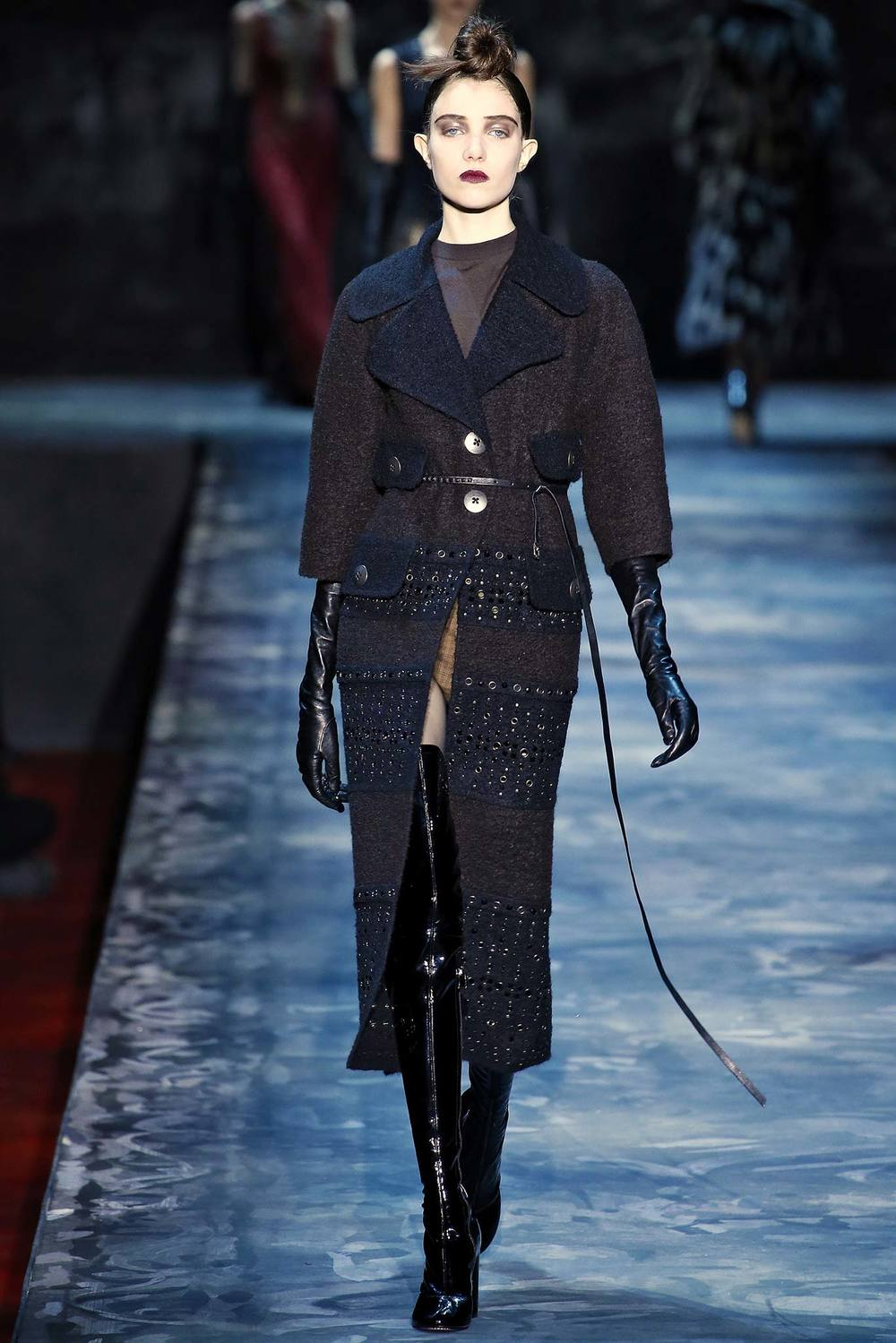 Featuring leash/belt, patent boots, and elbow- or opera-length gloves.