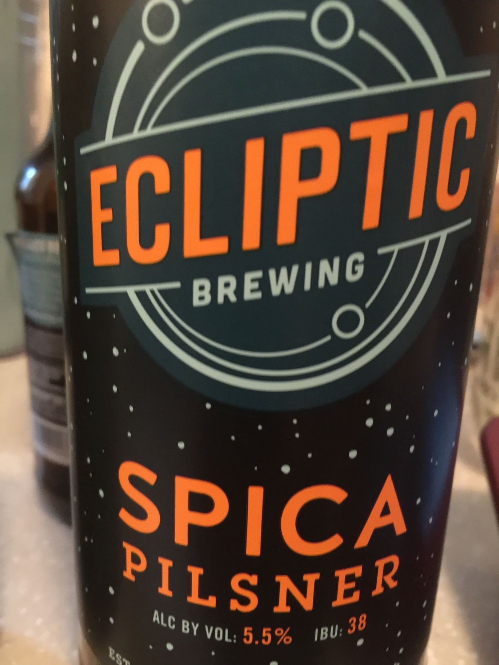 Ecliptic Spica Pilsner   A good beer for just being out with friends, doing activities. If you want to drink and still be functional, this beer is for you. Its a middle of the day beer. There is a surprise after taste to this beer that you don't get from other Pilsner beers  Rating: 6.75/10