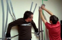 Guinness World Record for the Fastest Time to Duct Tape a Person to a Wall
