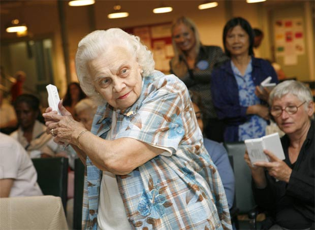 Senior citizen playing Wii in a nursing home