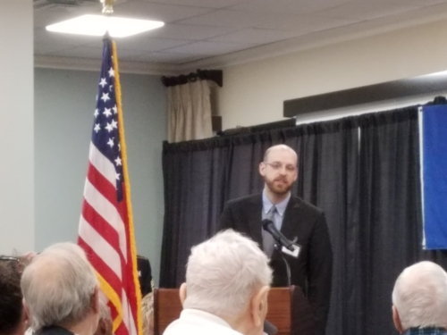 Jacob Toman giving remarks as a Chaplain during the Veterans Day service at LSC