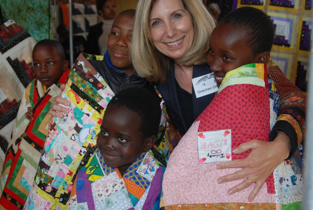 Help deliver Love Quilts to Vulnerable children in South Africa on November 16 & 17 2018. - Join us for a volunteer vacation to South Africa to wrap the children of Leamogetswe Safety Home  in the warmth of a Love Quilt. You'll be giving love and a better future to vulnerable children, many affected by the HIV / AIDS pandemic. It truly is a rewarding experience to give these orphaned children hope, love and more opportunity in their lives through education.After the quilt delivery in Pretoria with the Love Quilt Project team, you'll be free to explore the beauty and wonder of South Africa including areas such as Victoria Falls, Kruger National Park, Cape Town and Wine Country.