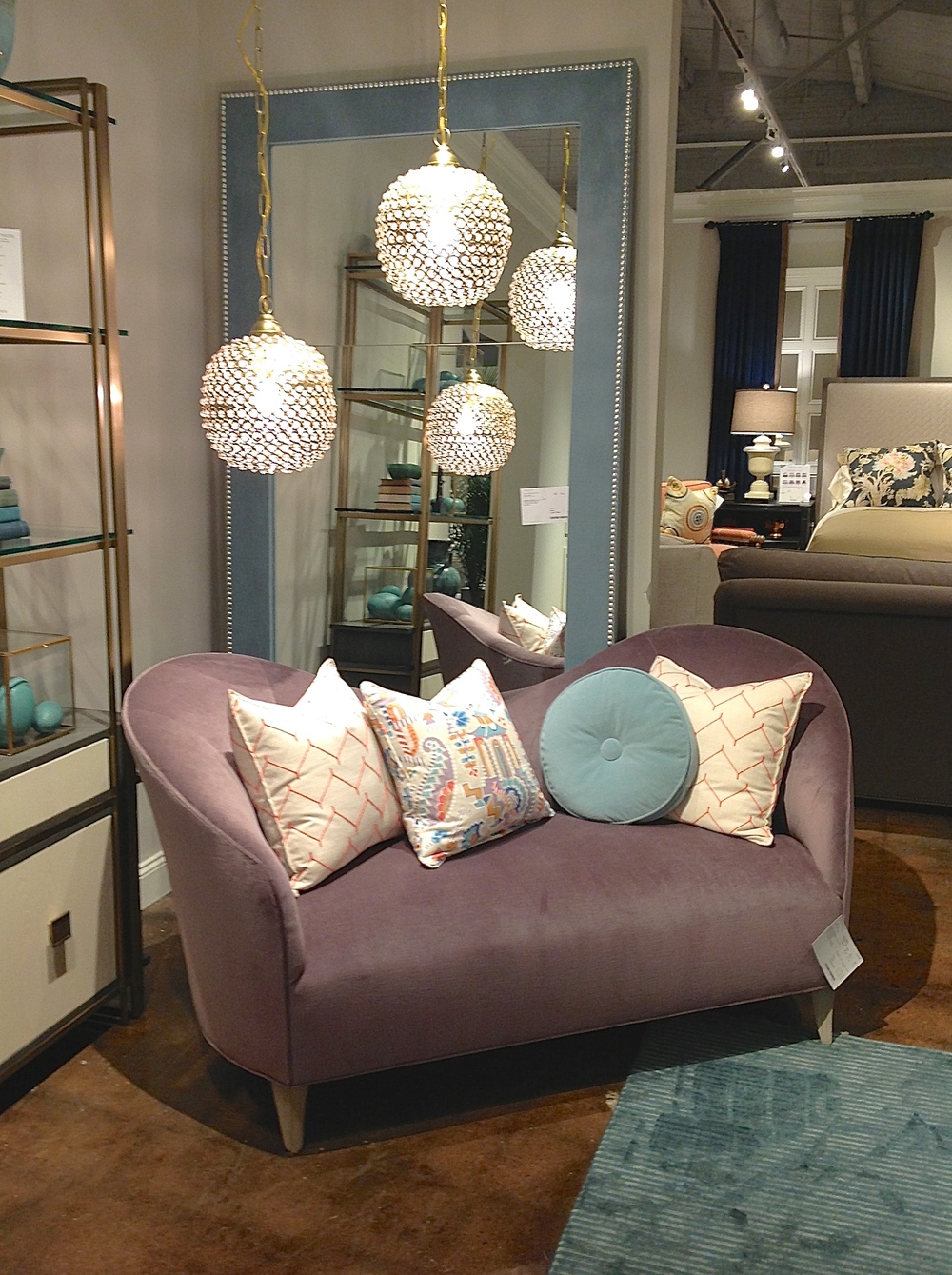 I'm loving everything about this setup - The playful lines of the sofa, the color scheme, the fun light pendants, and that beautiful mirror in the background! Customize any of these pieces with fabrics and finishes of your choice!