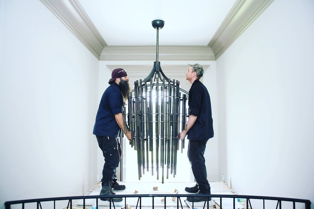 JL Studio teamed up with E. Kraemer Fine Metal and Woodwork to create the perfect chandelier.