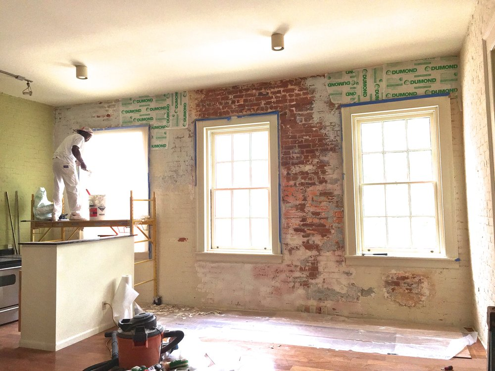 Condo renovation in progress (Stripping the brick)