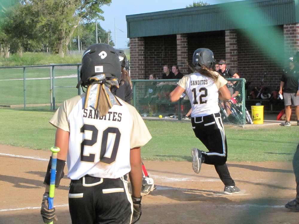 Pennington crossing home plate on an 2RBI single by Kalli Mallory that also scored Collins.