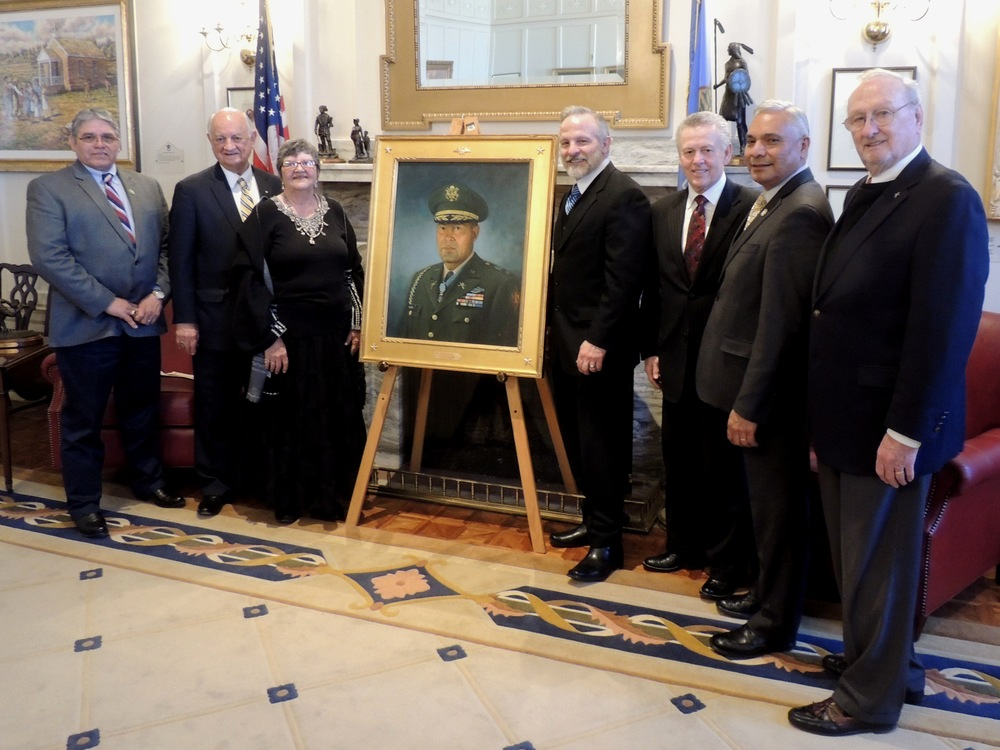 The Senate dedicated a portrait  Wednesday of Lt. Col. Ernest Childers, the only Native American Guardsman to earn the Medal of Honor.  Pictured L-R: Muscogee (Creek) Nation Second Chief Louis Hicks; Dr. Clarence Oliver; Childers' daughter, Elaine Childers; artist Mike Wimmer; Sen. Bill Brown; Muscogee (Creek) Nation Principal Chief James Floyd; and the president and founder of the Senate Historical Preservation Fund, former state Sen. Charles Ford.