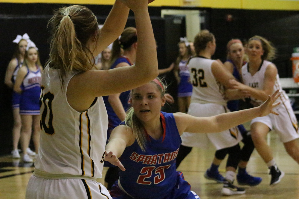Darrian Myles (Bixby) guards Jessica Collins (Sand Springs).