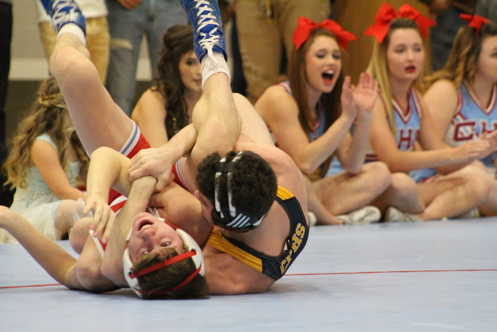 126  Jack Karstetter pins Collinsville's Pete Flippo in 0:29. Photo by: Virgil Noah