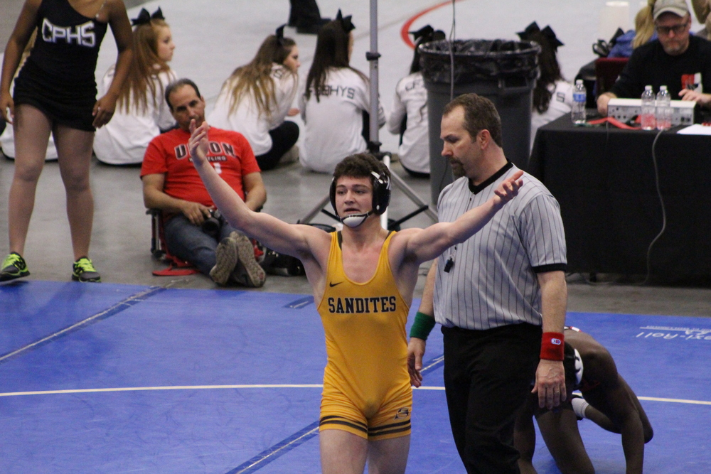 """Are you not entertained?""  Jack Karstetter encourages the crowd's applause after wining his match."