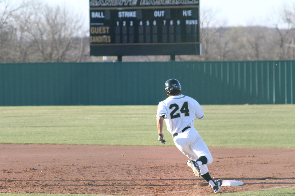 Rhett Rutledge rounds first base.