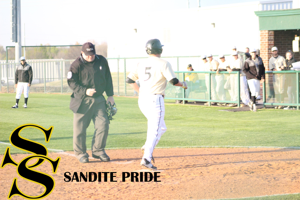 Jake Ward crosses home plate after hitting the first Sandite homerun of the season.