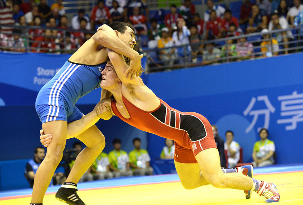 PHOTO: COURTESY\\ Fix takes down Kuatbek at the 2014 Youth Olympics.