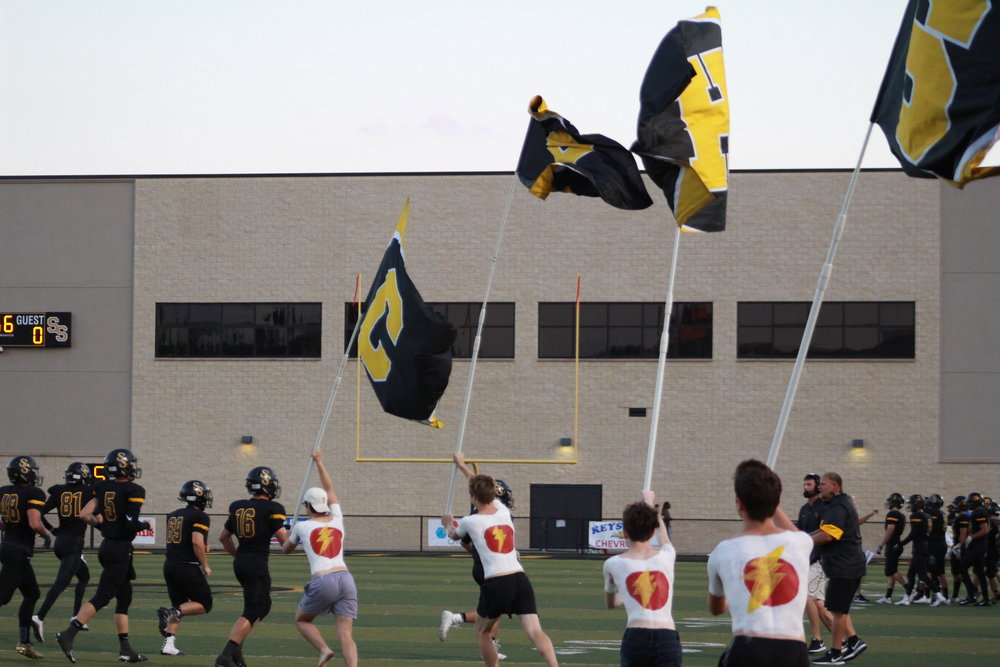 Sandite Flag Crew members are painted with the Flash symbol, which has been adopted by #SWIFTSTRONG supporters.
