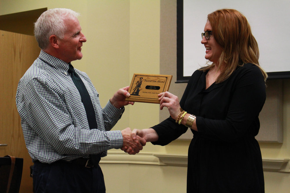 Board of Ed President Mike Mullins presents CNGC teacher Andrea Brice with the Sandite Pacesetter Award. (Photo: Scott Emigh).