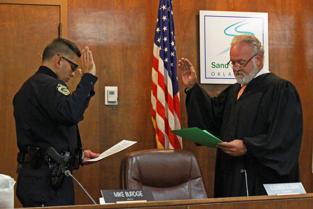 Municipal Judge Jay McAtee administers the Oath of Office to Police Officer Brian Tomsovic. (Photo: Scott Emigh)
