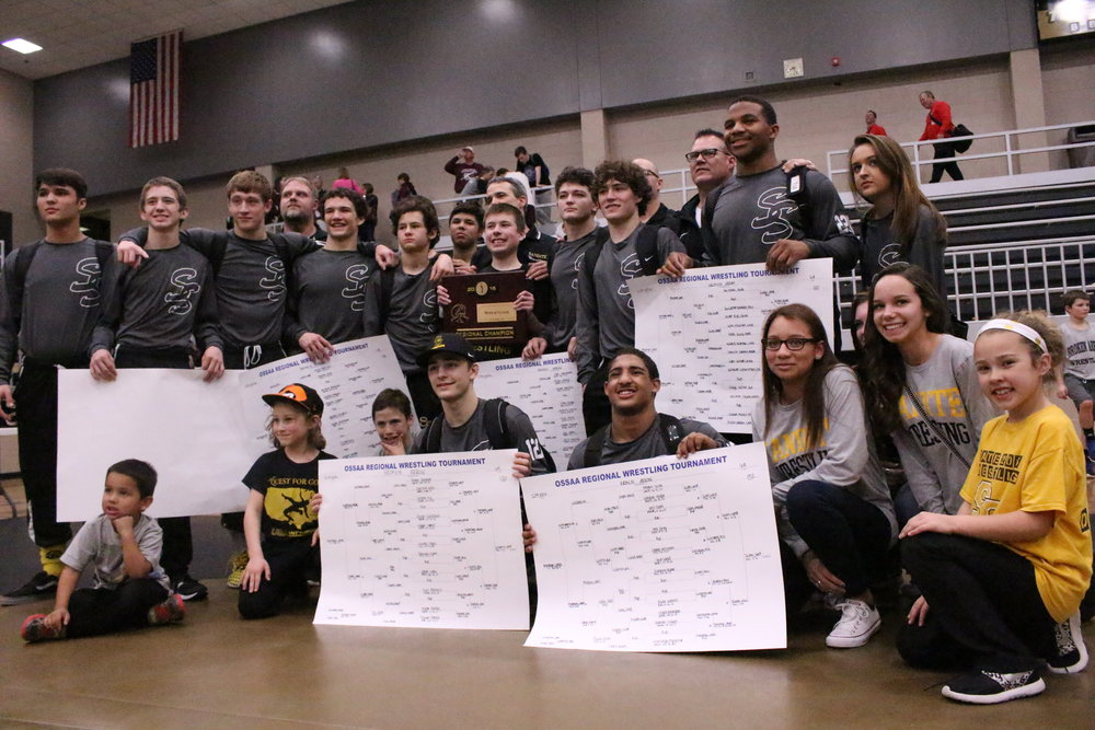 The 2015-2016 Sandites show off their Regional Championship plaque and brackets. Nine out of ten of last year's State Qualifiers will be returning this year.