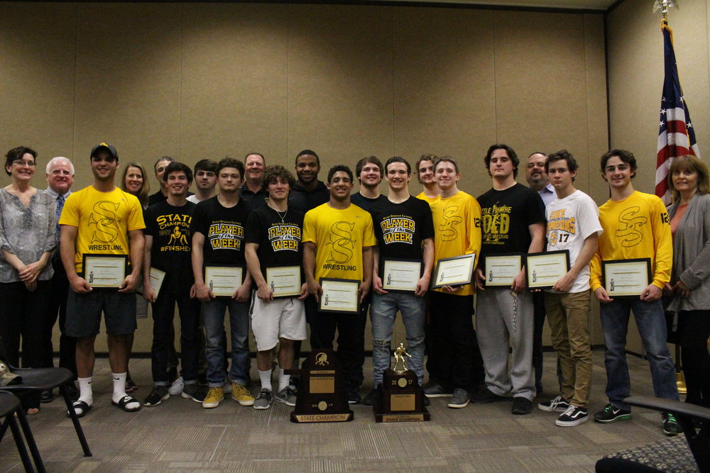 The Charles Page High School Wrestling Team starting lineup all received Sandite Spirit Awards for winning the State and Dual State Championships this last month. (Photo: Scott Emigh).