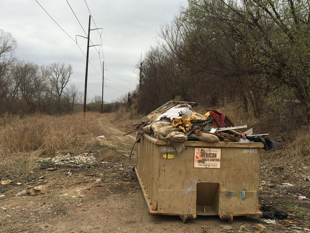 Volunteers filled four dumpsters with trash Saturday along the Arkansas River. (SUBMITTED).