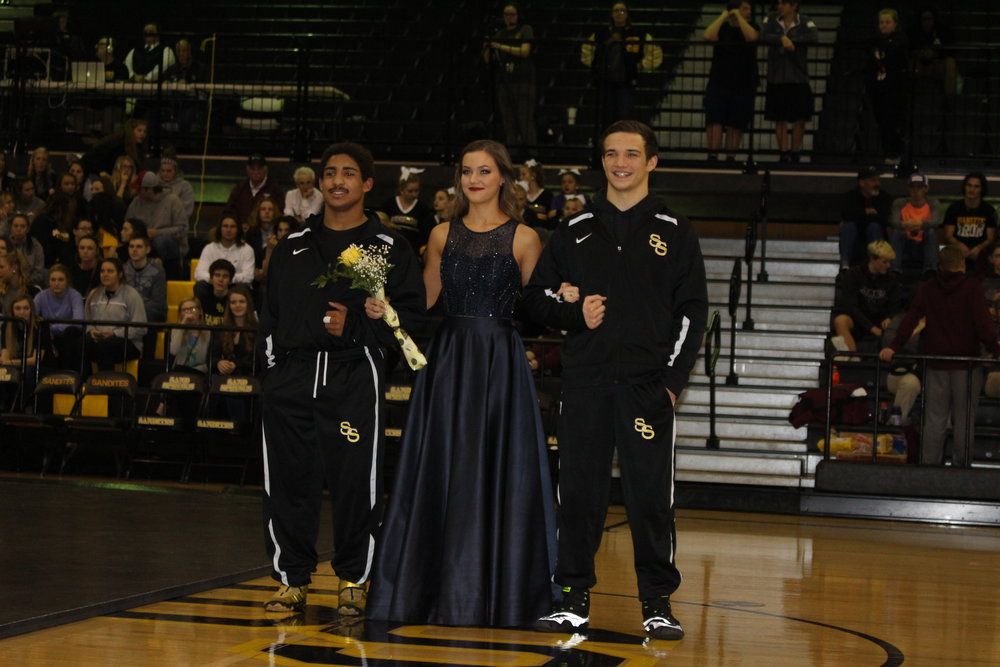 Homecoming Queen Sarah Noble, escorted by Beau Bratcher and Payton Scott.