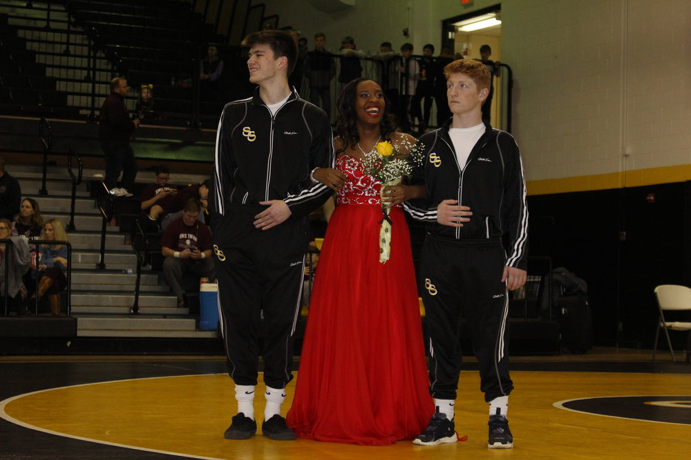 Homecoming Queen Candidate Jasmine Brown, escorted by Derek Davis and Mikey Burns.