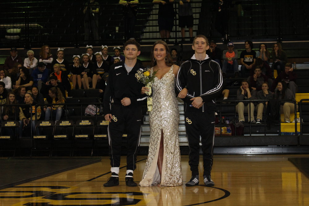 Homecoming Queen Candidate Julia Lewis, escorted by Jack Karstetter and Michael Ritchey.