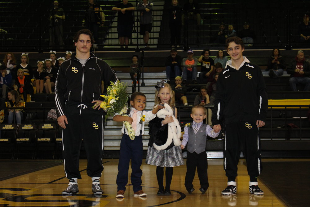 Gage Fain and Blake Sargent escort Little Princess Sawyer Briscoe, Little Prince Max King, and Little Prince Westyn Avey.