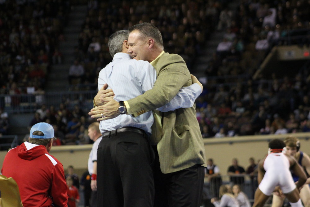 Coaches Kelly Smith and Derek Fix celebrate Daton Fix's State Championship win.