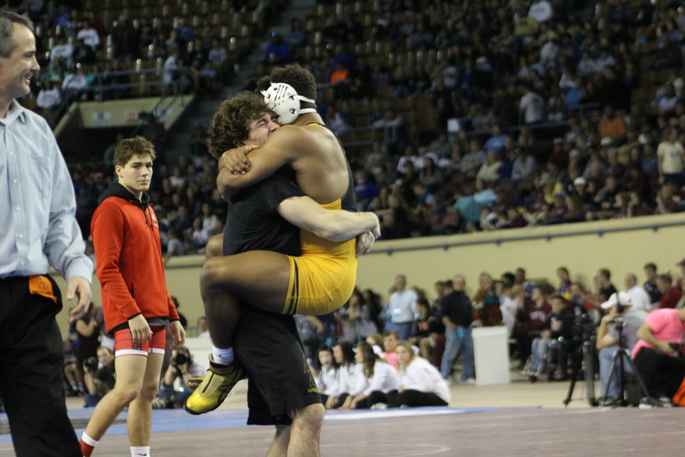 Payton Scott celebrates his first State Championship with Daton Fix.