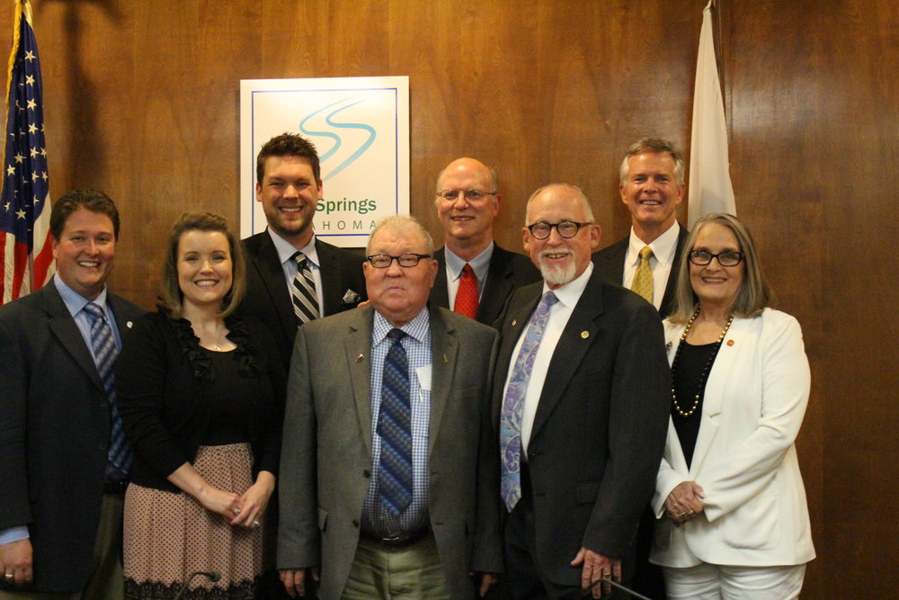 Left to right: Brian Jackson, Christine Hamner, Beau Wilson, Kim Tilley, Jim Spoon, Mike Burdge, Phil Nollan, Patty Dixon. Former Sand Springs City Councilman Kim Tilley with current councilmembers.