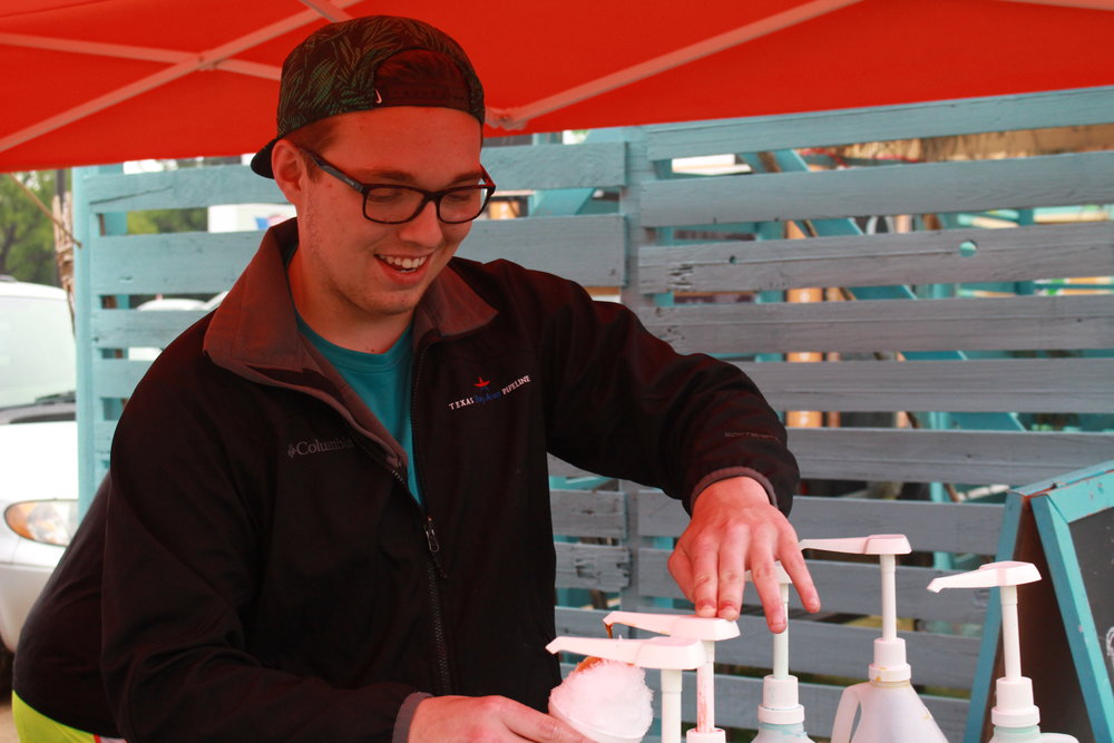 Jarrett Sabelo serves snow with a smile at the 2016 Harper's Hut Summer Kickoff. (Photo: Scott Emigh).