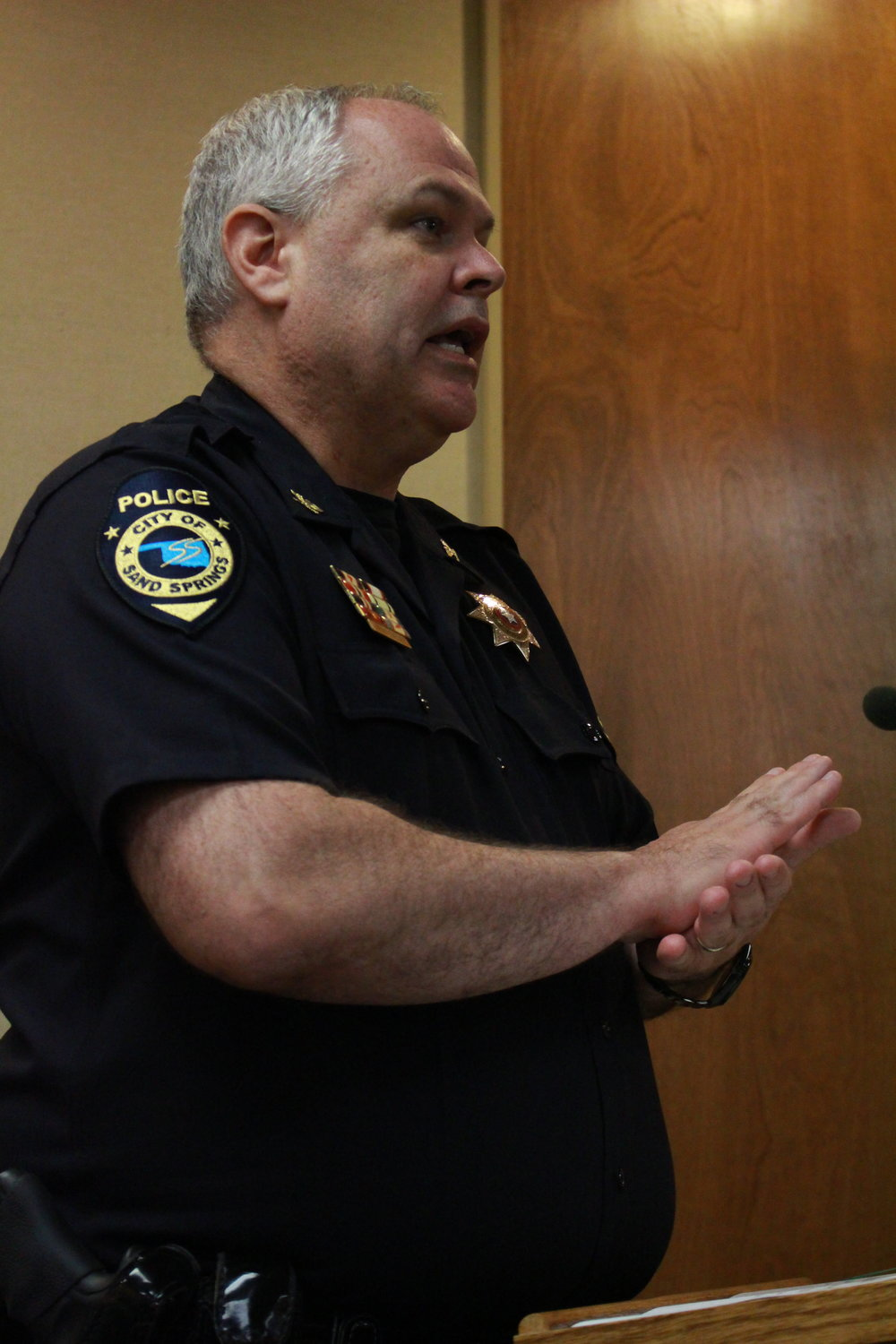 Sand Springs Police Chief Mike Carter speaks at a City Council Meeting.