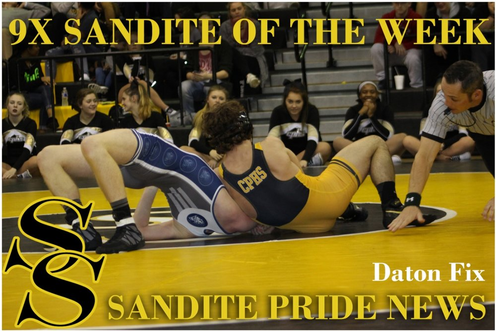Daton Fix pins his foe during a dual against Enid.  Click here to view the full gallery.