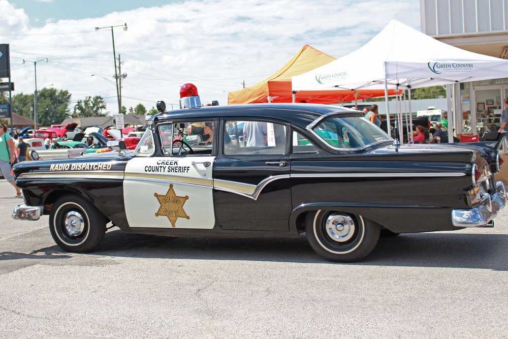 Mark Battenfield's retired Creek County Sheriff's cruiser on display at the first-annual Harper's Hut Classic Car Show.