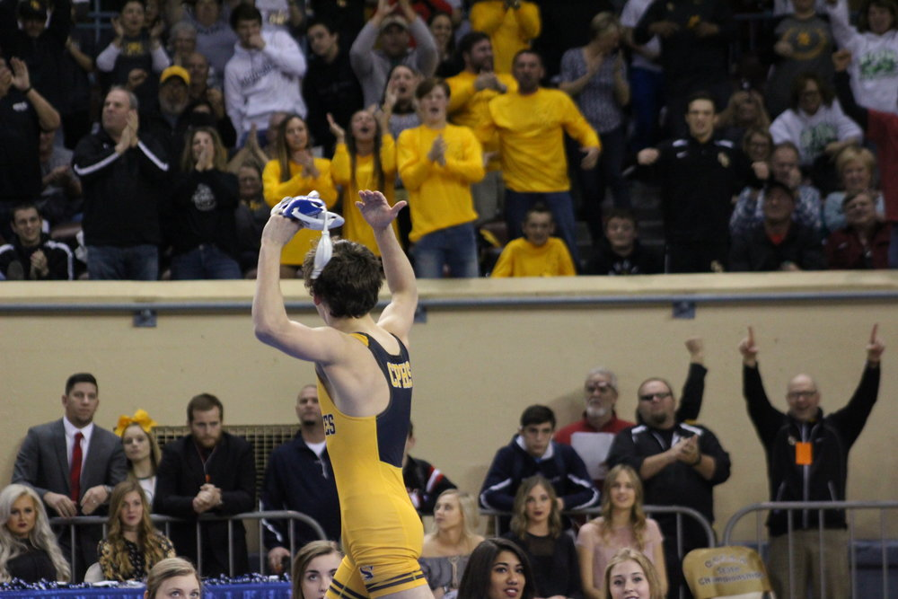 Riley Weir shows off for the crowd after winning his first State Championship. (Photo: Scott Emigh).