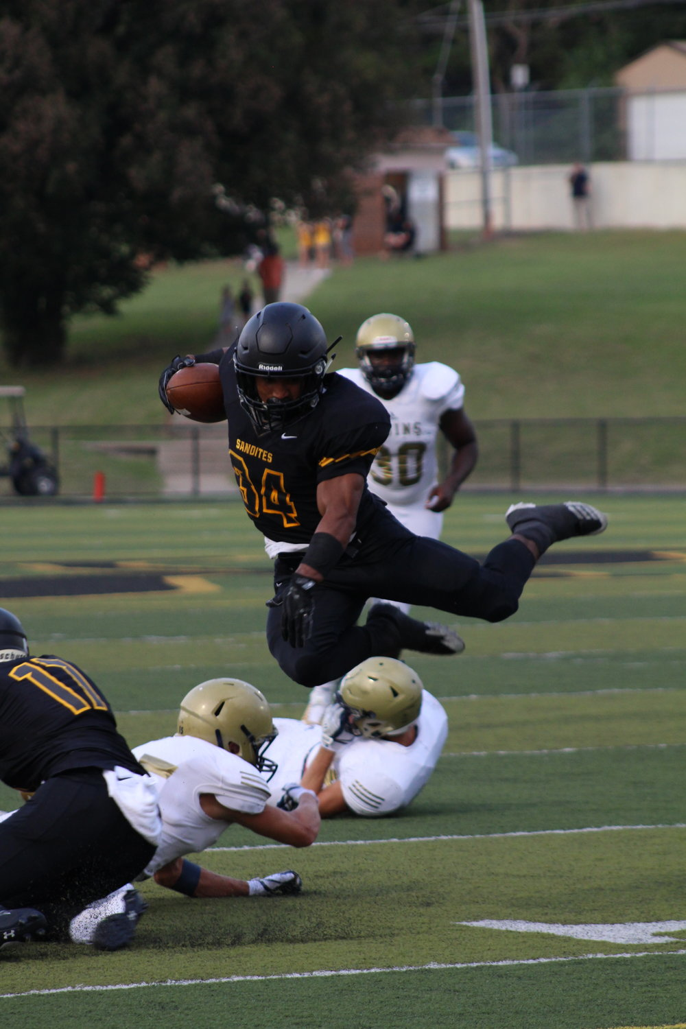 Senior running back Payton Scott goes airborne in a run against Pulaski Academy. (Photo: Morgan Miller).