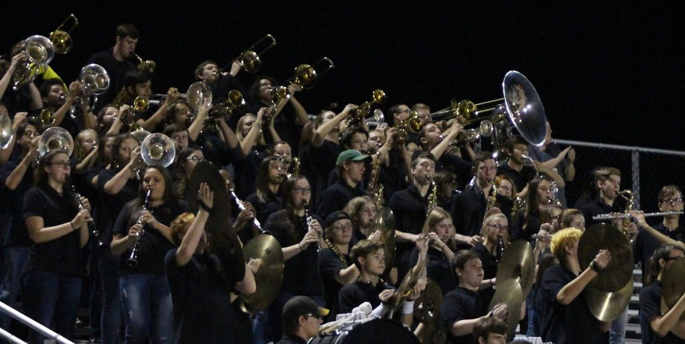 The Sand Springs Gold Pride marching band set the tone for the Sandites throughout the night. (Photo: Morgan Miller).