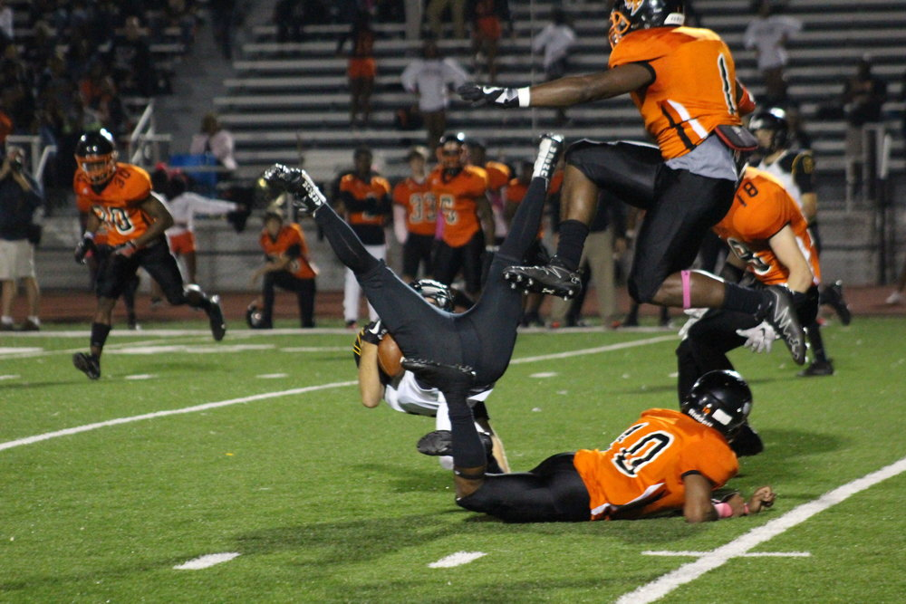 Braden Millican hauls in a radical catch in a 40-0 loss to Booker T. Washington. (Photo: Scott Emigh).