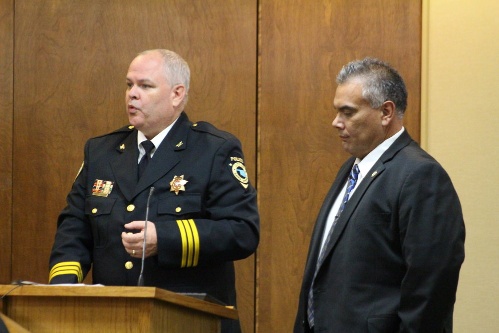 Sand Springs Police Chief Mike Carter (left) and Muscogee (Creek) Nation Lighthorse Police Chief Robert Hawkins (right) announce a cross-deputization agreement between their departments. (Photo: Scott Emigh).