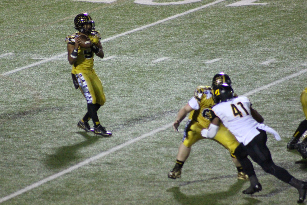 Current Pittsburg State freshman defensive end Delvin Jordan pressures Bomber quarterback Preston Colbert in the 2016 quarterfinals. (Photo: Virgil Noah).