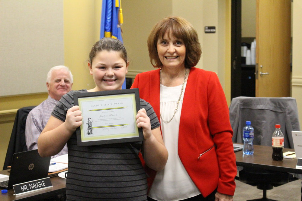 Board of Ed member Jackie Wagnon presents Joselynn Parrott with the Sandite Spirit Award. (Photo: Scott Emigh).   Click here to view full meeting photo gallery.